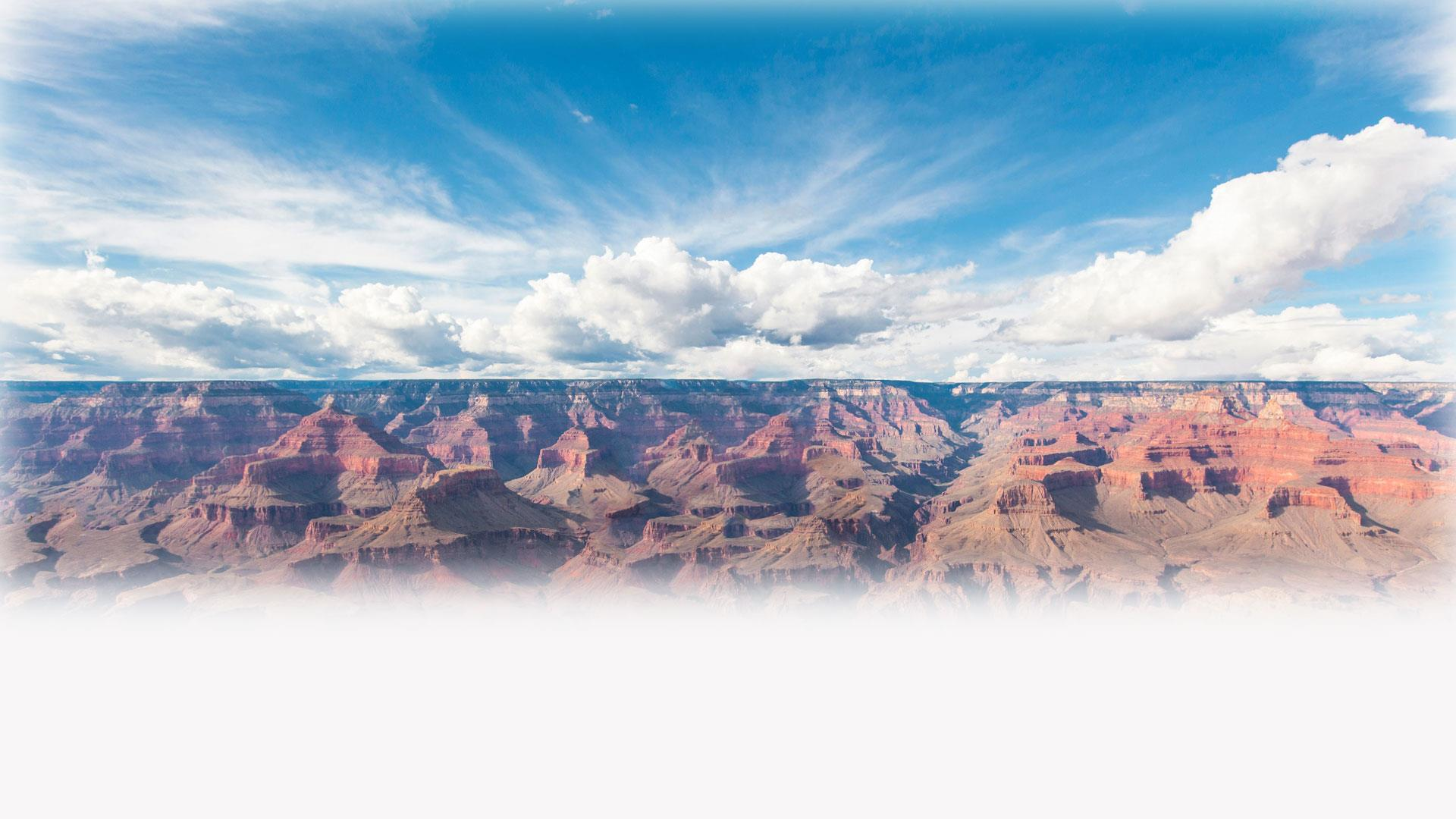 Panoramic view of red valley and skyline with clouds