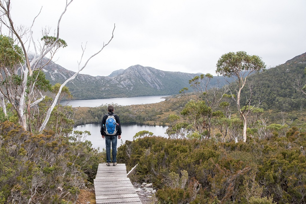 Exchange student looking at lake in Tasmania