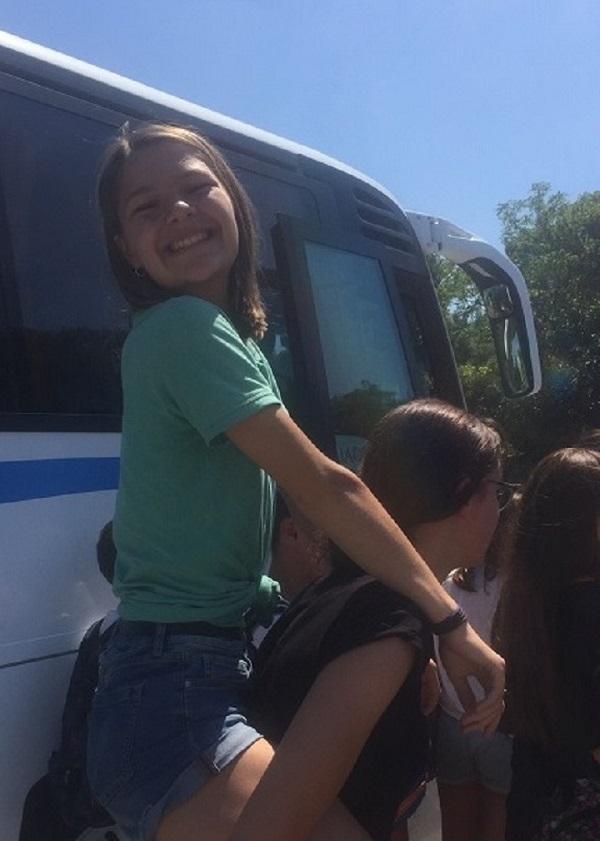 Language travel student having a piggyback