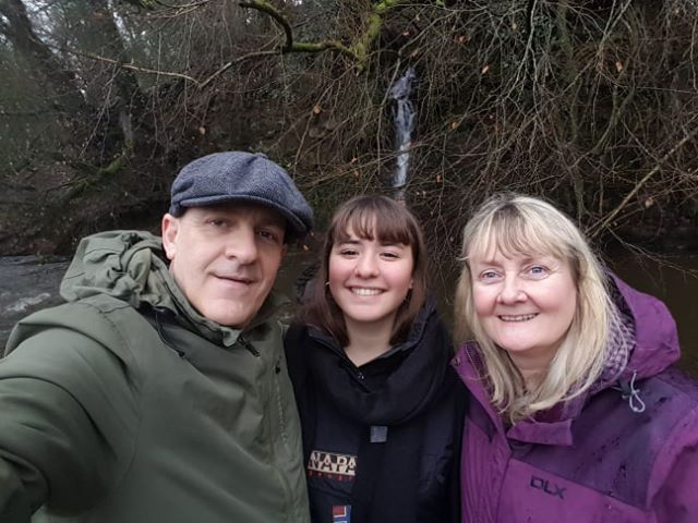 Host family with exchange student at waterfall