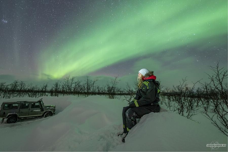 Exchange student watching Northern light in Tromsø