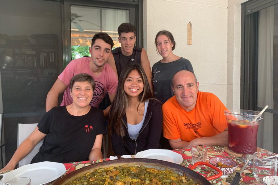 Spain exchange student with host family and paella