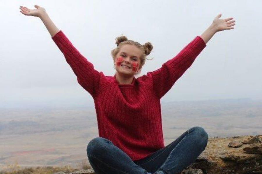 Happy exchange student on a mountain